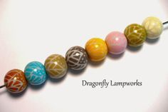 Experiment in Color No.2:  An Autumn themed set of lampwork glass beads by Heather Sellers.