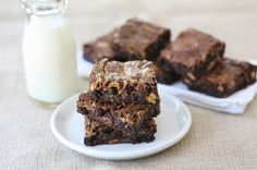 10 recipes using leftover Halloween candy like these Peanut Butter Snickers Brownies. (Whoa.)