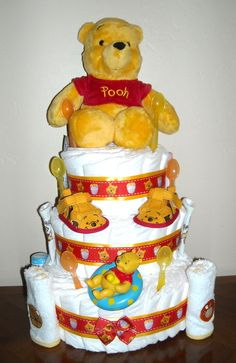 Winnie the Pooh Diaper Cake.  $60   Check out my other diaper cakes at http://www.facebook.com/CushieTushieCakes