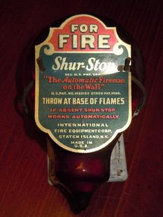 Red Shur-Stop Fire Extinguisher