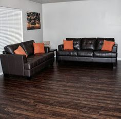 Laminate gives the same look of hardwood but is easier to maintain.