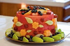 Raw Food Revolution - Watermelon shaped cake, with apples, blueberries, cantelope, melon, strawberries, oranges, etc. Cut a watermelon in the shape of a round cake, and decorate with your favorite fruits.