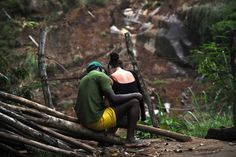 January 22, 2011. A couple sit near the debris left by landslides and floods in the municipality of Nova Friburgo, in Rio de Janeiro, Brazil.