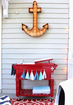 Fun Nautical Porch with DIY Anchor Marquee: http://www.completely-coastal.com/2014/08/nautical-porch.html