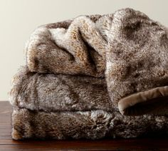 Faux Fur Throw - Caramel | Pottery Barn  They also have it in a wolf grey