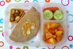 An easy bento lunch from Bentobox.net -- Shannon lets her kids personalize their lunches with simple add-ons, but stick to the basics.