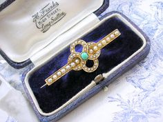 Victorian Scottish 15ct Gold Celtic Lovers Knot Brooch with fine Antique Pearls and Turquoise.  The brooch is an Eternal knot of entwined figure Eight shapes symbolic of Eternal Love.  http://www.kittysantiquejewelry.com/Victorian-Brooch-Lovers-Knot-p/br10258.htm