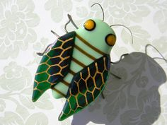Harvey Cicada the Botanist - Fused Glass Insect Sculpture - signed by artist - green brown gold woodland garden home decor. $25.00, via Etsy.