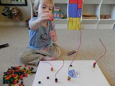 push wire through Styrofoam, string beads or pasta