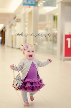 10 month old girl photo shoot idea in a mall with COACH purse #spoiled