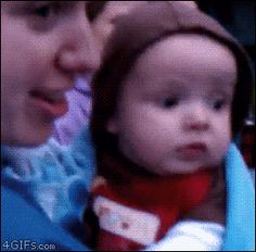 Baby watches fireworks for the first time.