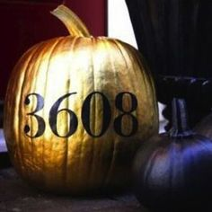spray painted pumpkin - house numbers