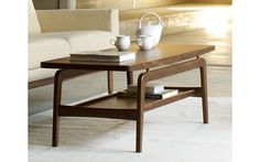 This is exactly the coffee table I've been looking for for ages, vintage-inspired and warm from being made of wood, but with a second shelf for additional storage. Skagen Coffee Table, Walnut at DWR $1260
