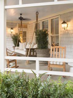Porch Swing ~ tall planters, wall sconses ~ Rebecca Gardner PalmettoBluff