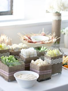 Love the burlap ribbon or fabric around the serving pieces on the buffet. Simple way to incorporate this design element of your sunflower and burlap theme!