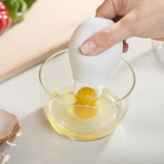 "This handy, dandy gadget is called a ""Pluck"" and it will suck up the yolk from your egg without breaking it, leaving just the white behind. You then can place the yolk in a separate bowl and use it for something else or simply throw it away.  Cool huh?"
