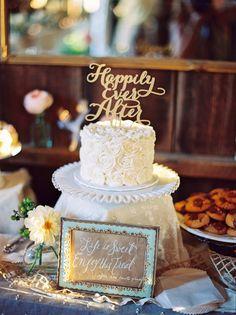 Happily Ever After, photo by Danielle Poff http://ruffledblog.com/dana-powers-house-wedding #weddingcake #cakes #caketopper