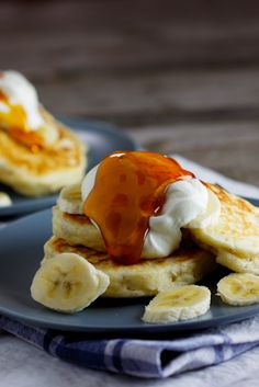 pancakes with crunchy cereal inside and topped with greek yogurt and honey