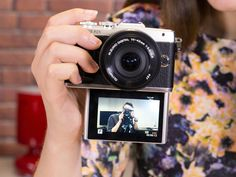 Olympus' new Pen E-PL7 has the same retro design but now allows you to flip down the screen a full 180 degrees to see yourself in the frame. You will be on top of your selfie game with a professional camera!