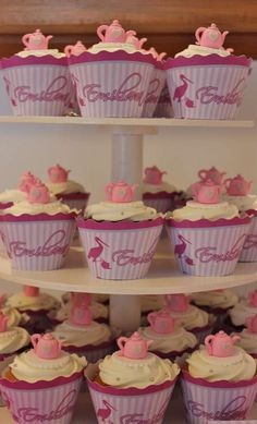 Teapot topped cupcakes at a Tea Party Baby Naming Party!  See more party planning ideas at CatchMyParty.com!