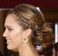 I really like the side braid and the back of this hair style. Could place vail above the messy bun.