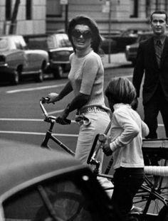 Jacqueline Kennedy Onassis and John Jr ride bikes in Central Park 1969.jpg
