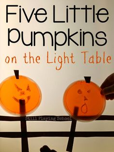 Five Little Pumpkins on the Light Table with Recycled Dry Erase Jack-o-Lanterns from Still Playing School