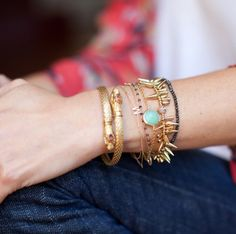 """The grown-up """"arm party"""": When wearing dainty chains, be sure your larger items are not too overpowering."""