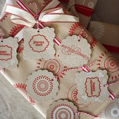 assorted tags - red and white on kraft paper