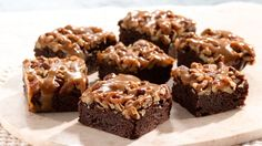 Dense, extra-fudgy brownies get their rich flavor from Dutch-processed cocoa and bittersweet and unsweetened chocolate. They're drizzled with a caramel topping that adds an irresistible gooey finish.