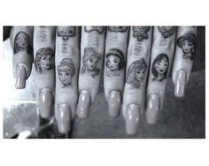 I don't care for hand tattoos but this is pretty cute...distinct faces
