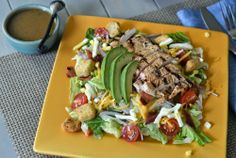 A quick grilled chicken cobb salad that uses the marinade (divided) as the base for the vinagrette dressing too for complementing flavors.