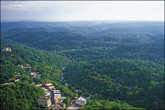 Historic downtown Eureka Springs, Arkansas nestled in the Ozark mountains--aerial view