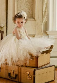 Suitcases used as photography props: Toddler flower girl in a tutu dress / Etsy