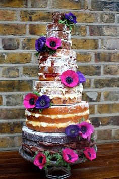 Bare Naked Wedding Cakes: design/presentation ideas. Frosted layers, but powdered sugar on top w/ flower accents <3
