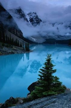 View of Moraine Lake with low-lying clouds at one end, Alberta, Canada Art Print