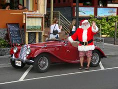 Going on a ride on Santa's red beamer in Kona on the Big Island #Aqua12staysofchristmas