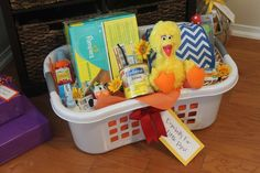 Baby shower basket with a Sesame Street theme!  See more party planning ideas at CatchMyParty.com!