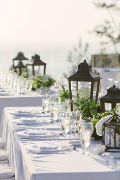 Gorgeous lantern and floral centerpieces for a seaside wedding #beach #coastal #wedding