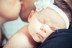 Beautiful Baby Newborn Photo with parents   kissing        Nicole Christine Photography
