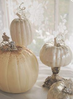 Decorate Little Pumpkins: Paint the pumpkins and let dry. Hot glue your decorations on. Use a paintbrush to cover the tops with glue and scatter with glitter. Arrange on silver or mercury glass votives and candlesticks.