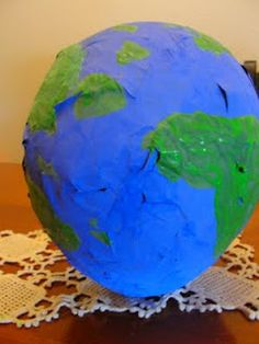 Globe made from a balloon, newspaper, mod podge and paint
