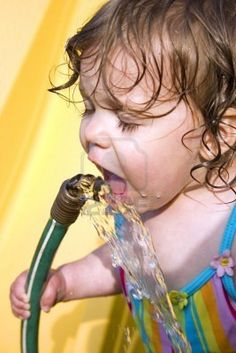 Drinking from a garden hose.
