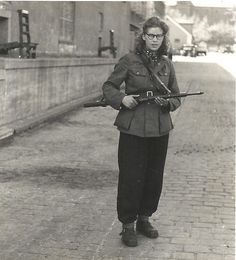 Woman freedom fighter with rifle at the Carlsberg Breweries. May 1945. National Museum of Denmark via Flickr.