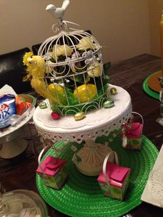 Bird with easter eggs, table centerpiece with favors displayed on bottom tier.
