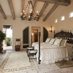 Master bedroom - Tuscan style... love the light wall color with wood