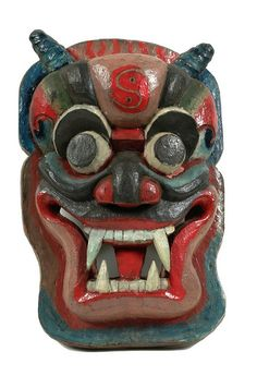 A Chinese anti-demon door mask intended to frighten away evil spirits; it has a yin-yang symbol on its forehead. (Birmingham Museum and Art Gallery, via Flickr)