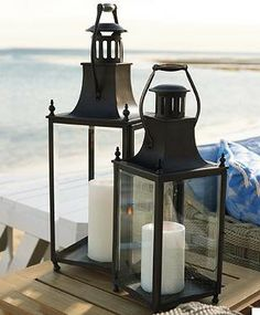 Our stately Beacon Lantern in two large sizes showcases delicate candlelight for evening entertaining.