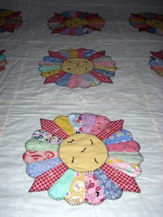 Dresden Plate quilt from feed sack reproductions - lots of hand applique - I did the blanket stitch with pearl cotton.