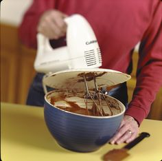 To prevent splatters when using a hand mixer, make a shield from a paper plate. Cut holes in the center of the plate. Hold the plate against the bottom of the mixer, and insert the beaters into the mixer.